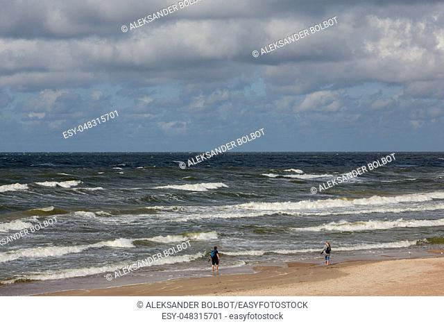 Baltic Sea beach with cloudy sky in Palanga Resort with playing children, Palanga, Lithuania, Europe