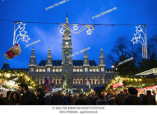 Austria, Vienna, Rathausplatz Christmas Market by Town Hall, evening