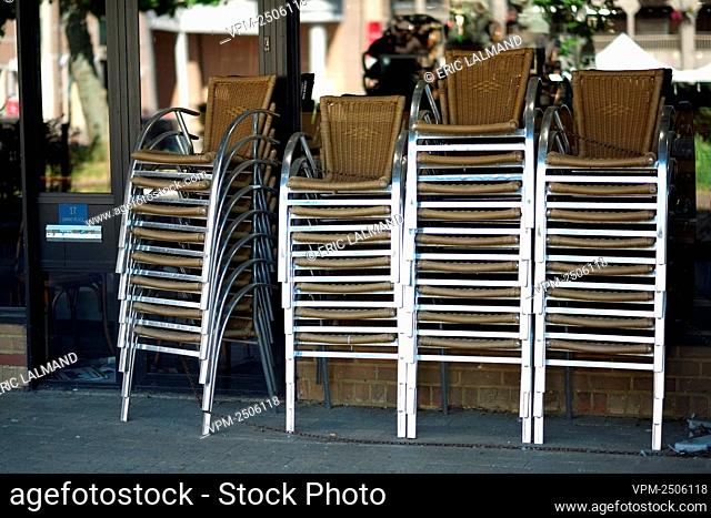 Illustration picture shows piles of chairs on the terrace of cafe and restaurant which are closed since last March 13th, in Louvain-La-Neuve