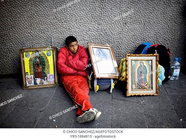A pilgrim sits by images of Our Lady of Guadalupe virgin in Mexico City, December 6, 2008  Hundreds of thousands of Mexican pilgrims converged on the Our Lady...