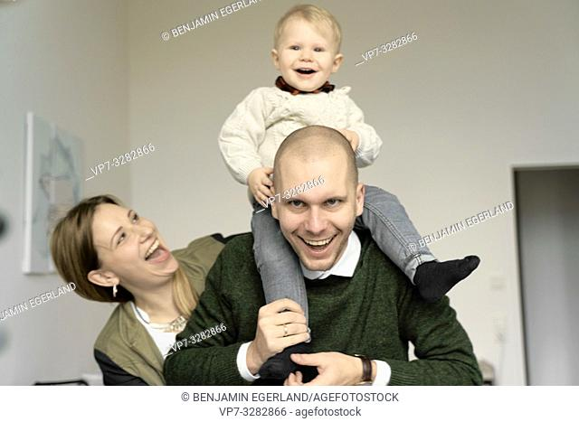 little family, parents with baby toddler child at home, in Cottbus, Brandenburg, Germany