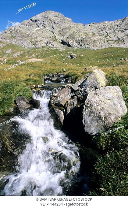 Small waterfall flowing from a rocky mountain