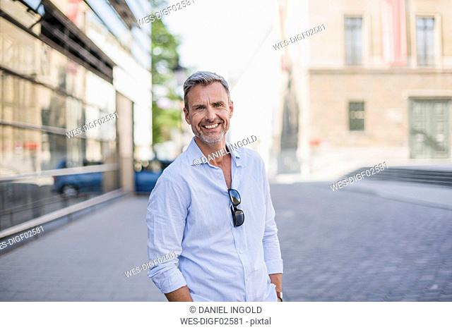 Portrait of smiling man in the city