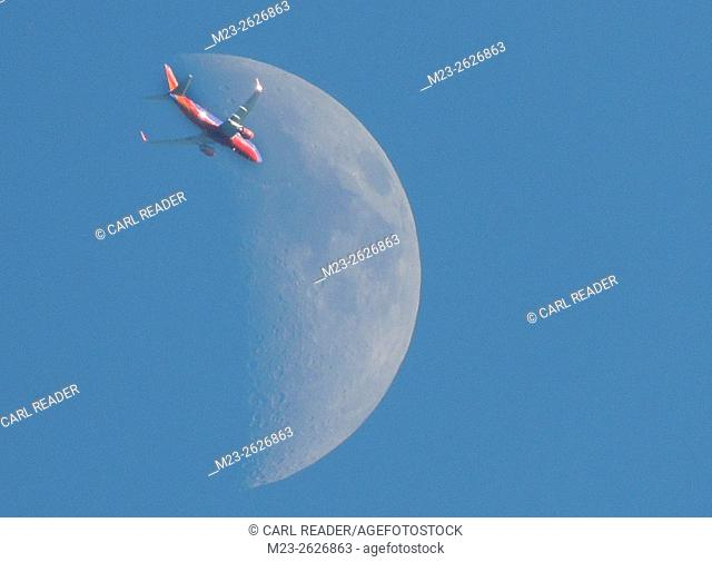 A colorful jetliner seems to head for the moon, Pennsylvania, USA