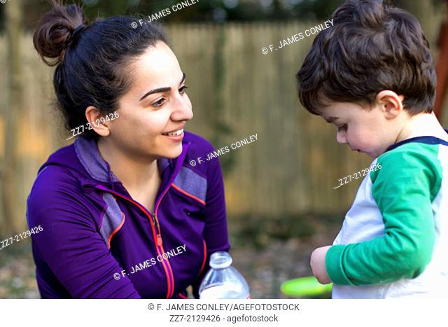 A young Iranian woman talks to her son