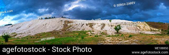 "Pamukkale, Turkey â. "" 07. 15. 2019. Pamukkale white Mountain on a cloudy summer morning"