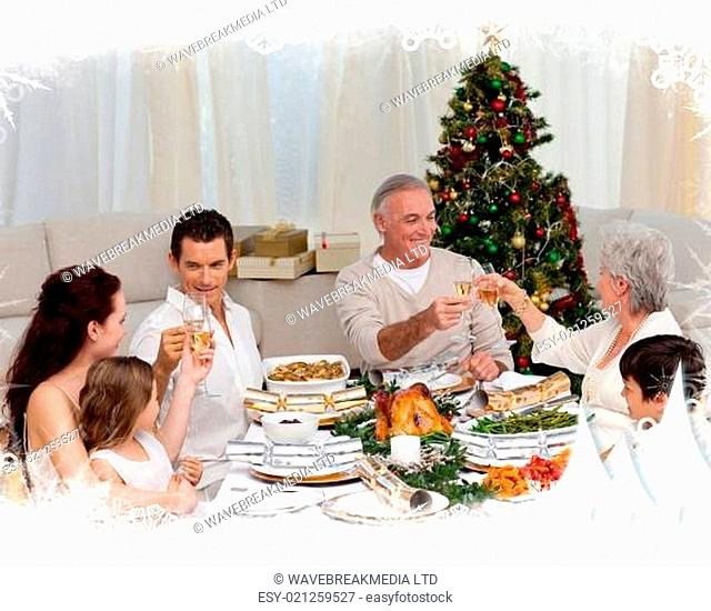Grandparents and parents toasting in a christmas dinner