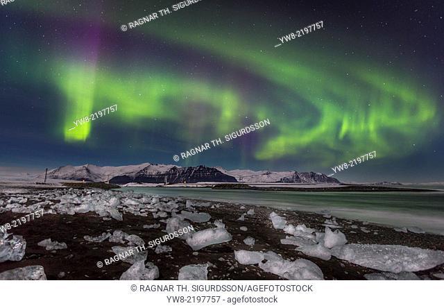 Aurora Borealis and Icebergs on the black sands, Breidamerkursandur, Vatnajokull Ice Cap, Iceland