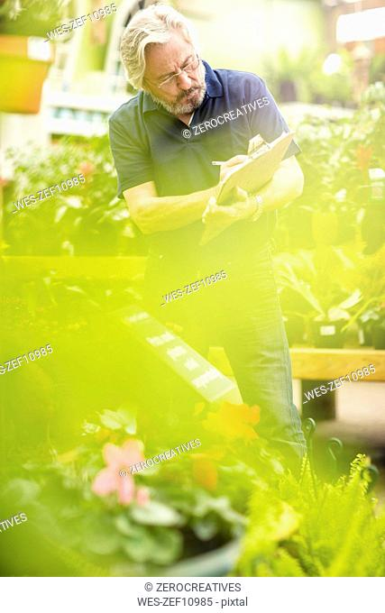 Man working at garden centre