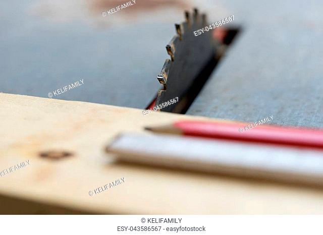 Circular saw with pencil and folding rule to measure
