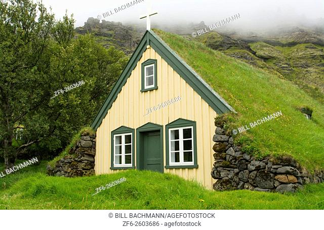 Iceland Hofskirkja yellow church turf grass in town of Hof in South Iceland 1884 the last turf church in Iceland