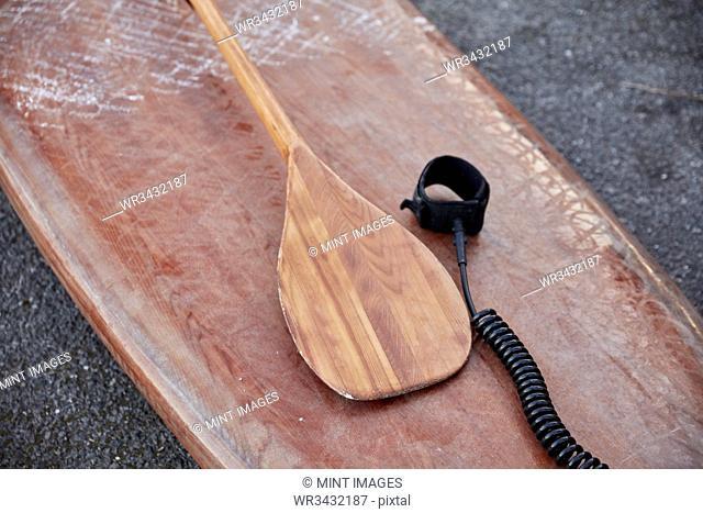 Close up of paddleboard and paddle