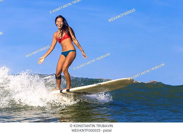 Indonesia, Bali, woman surfing