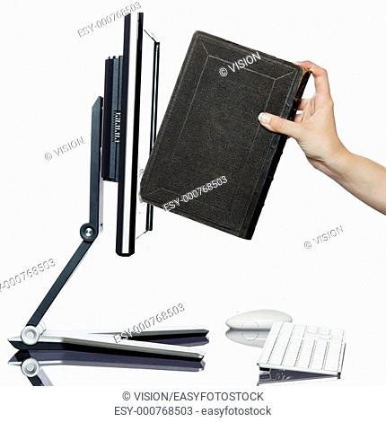 woman hand put book in computer display isolated studio on white background