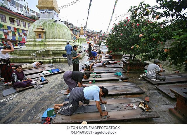 Tibetan Buddhists praying at the Boudhanath Stulpa in Kathmandu