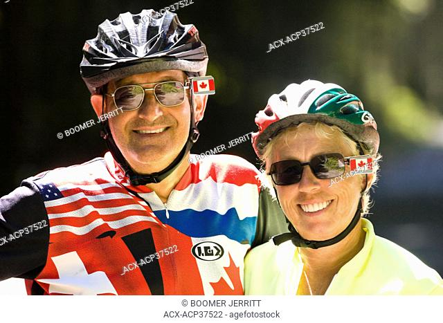 Two cyclists pause for an informal portrait while biking near the Sooke Potholes along the Galloping Goose Trail on Southern Vancouver Island