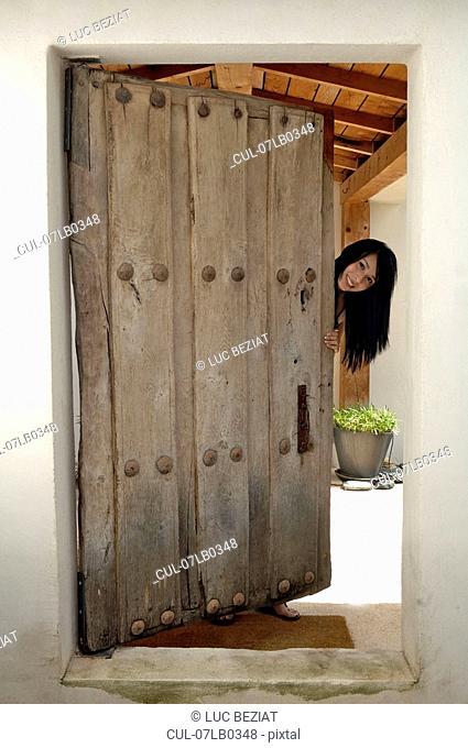 Woman opening front door