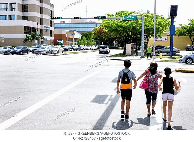 Florida, Miami, Coral Way, 27th Avenue, street, intersection, crossing, red light, car, traffic, Hispanic, woman, boy, girl, mother, son, daughter, child
