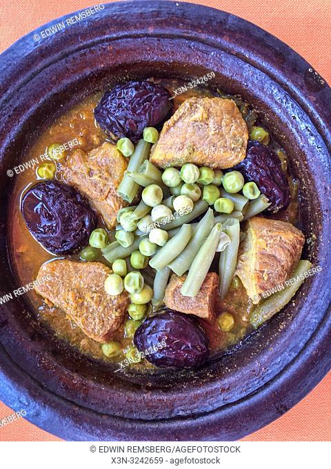 Lamb with prunes tagine served in a tagine dish, Morocco