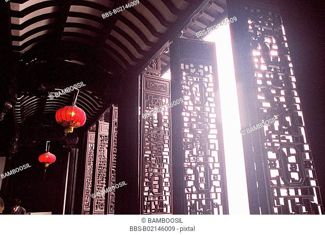 An old house with carving on wood windows in Wu Town, Tongxiang City, Zhejiang Province of People's Republic of China