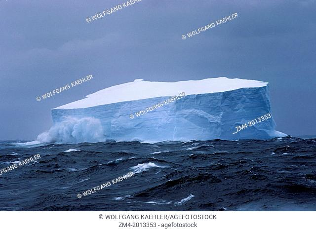 ANTARCTICA, ICEBERG IN ROUGH SEAS