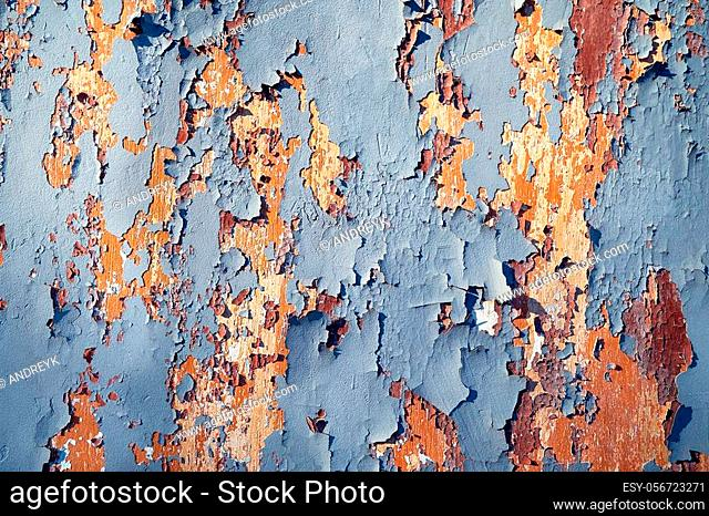 Beautiful textured surface with many layers of paint of different colors that have collapsed over time