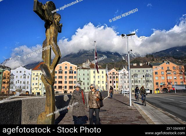 The crucifix by Rudi Wach on the bridge across the river Inn near the historic town centre of Innsbruck, Austria