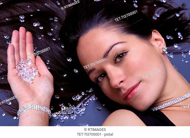 Woman lying down with diamonds