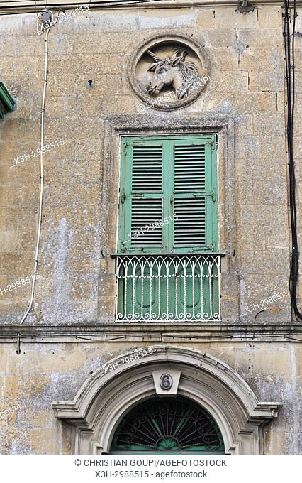 facade with a sculpted unicorn in medallion, Mdina, Malta, Mediterranean Sea, Southern Europe