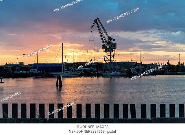 Shipping crane at sunset, Gota alv, Gothenburg, Sweden