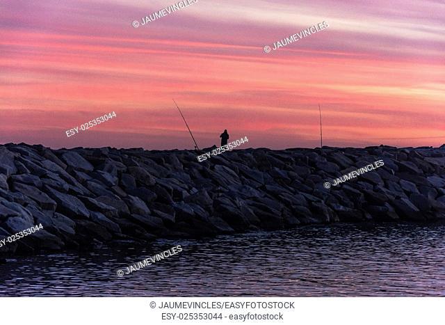 Fishing in a quiet evening. Port Balis, Sant Andreu de Llavaneres, Maresme, Barcelona province, Spain