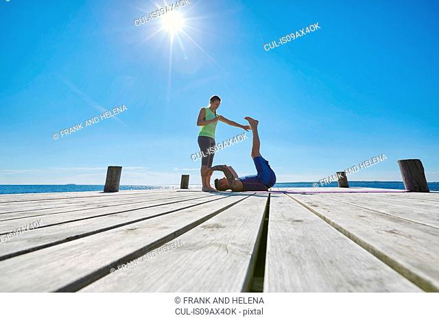 Mid distance view of women on pier exercising