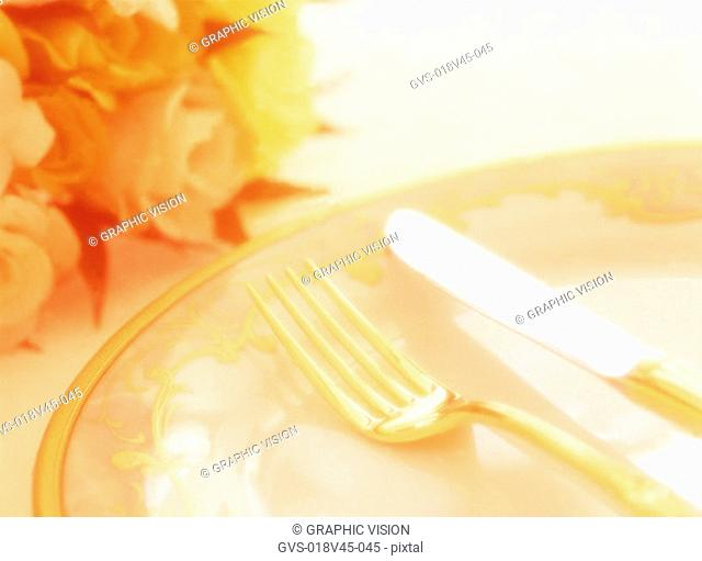 Close Up of a Knife Fork Plate and Flowers