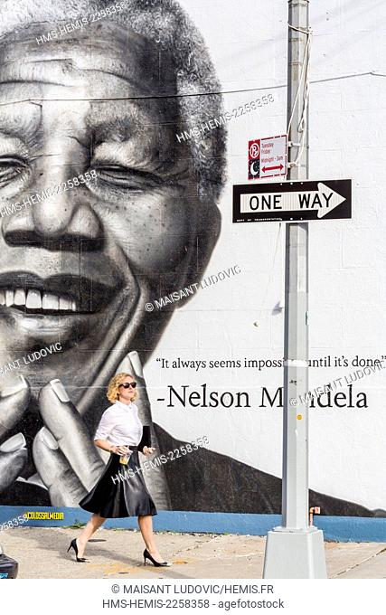 United States, New York, Brooklyn, Williamsburg district, New York passed a mural representing Nelson Mandela