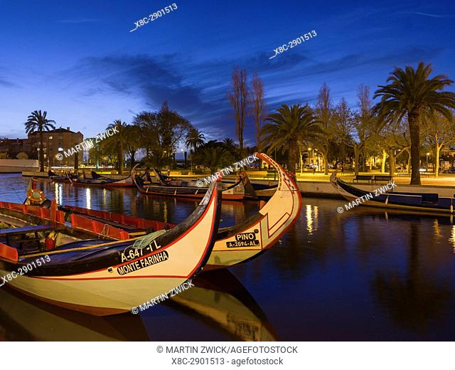 Sunset over the Canal Central with the traditional Moliceiro Boats. Aveiro in Portugal on the coast of the Atlantic. Because of the many channels Aveiro is...