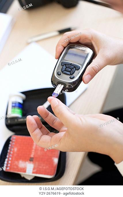 Diabetic woman measuring sugar