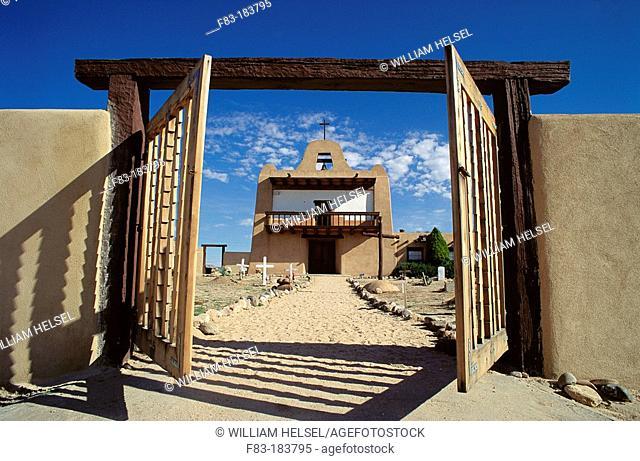 Adobe church and gate. San Ildefonso Pueblo. New Mexico. USA
