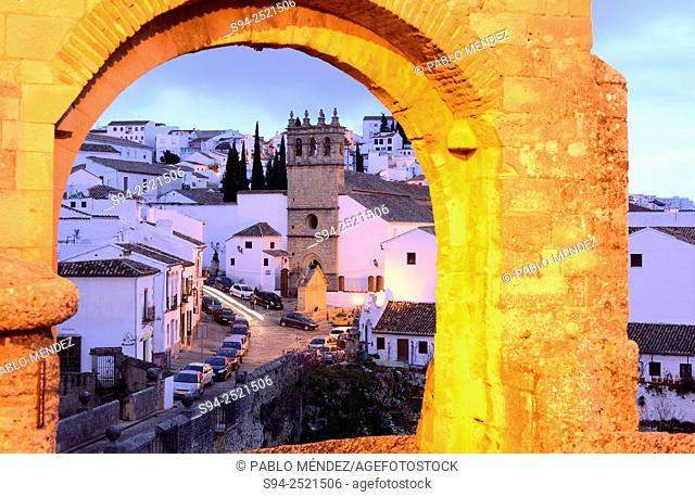 View of the church of Padre Jesús and arch of Felipe V in Ronda, Malaga, Andalusia, Spain