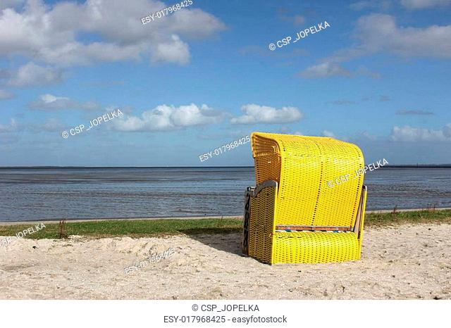 Yellow beach chair on the North Sea