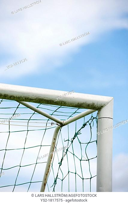 Blue sky and detail of football goal