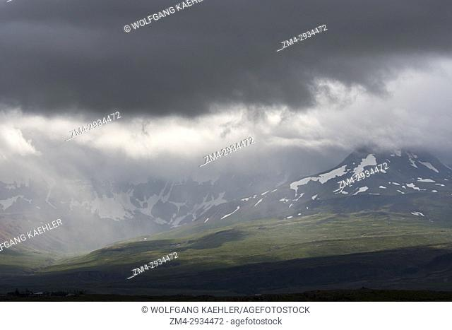 View of the Borgarfjodur and the Skardsheidi mountain range in the rain near Hvanneyri in western Iceland