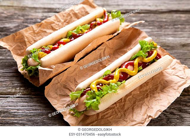Hot dogs on old wood background