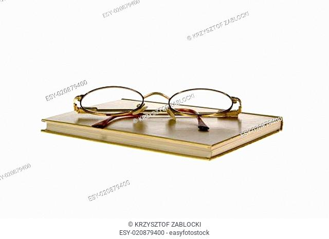 hardcover book and glasses on White Background