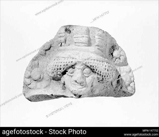 Molded plaque: female head. Period: Ur III-Isin-Larsa; Date: ca. 2100-1750 B.C; Geography: Southern Mesopotamia; Medium: Ceramic; Dimensions: 1.57 x 2