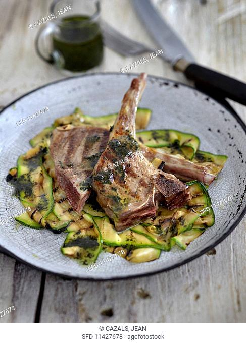 Grilled lamb chops on a bed of courgettes
