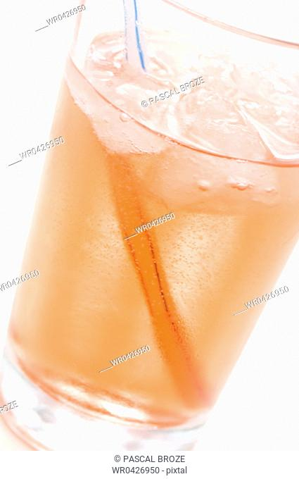 Close-up of a glass of grenadine syrup with a drinking straw