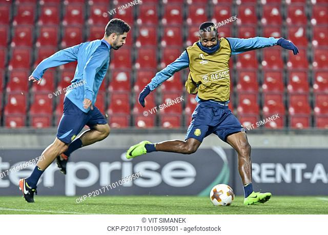 From left soccer players of Villarreal CF ALVARO GONZALEZ and CEDRIC BAKAMBU in action during the training session prior to the European Football League 4th...