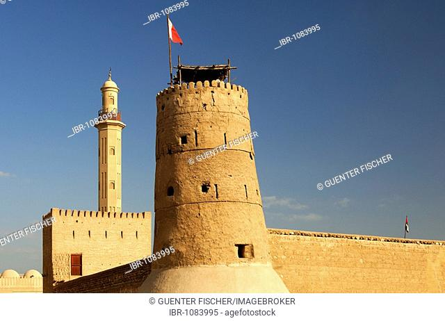 Traditional watchtower with national flag in Al-Fahidi-Fort, oldest building in Dubai and part of the Dubai Museum, Dubai, United Arab Emirates