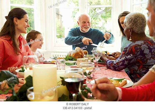 Multi-ethnic family enjoying Christmas dinner table