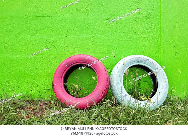 Tires leaning against painted wall, Bright Puerto Rican colors, San Juan, Puerto Rico